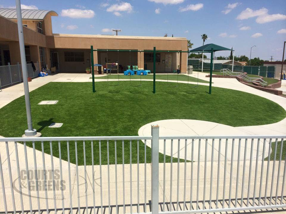 professional playground with synthetic turf designed by Courts and Greens in Bakersfield