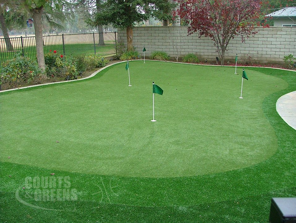 classy backyard putting greens by Courts and Greens in Bakersfield