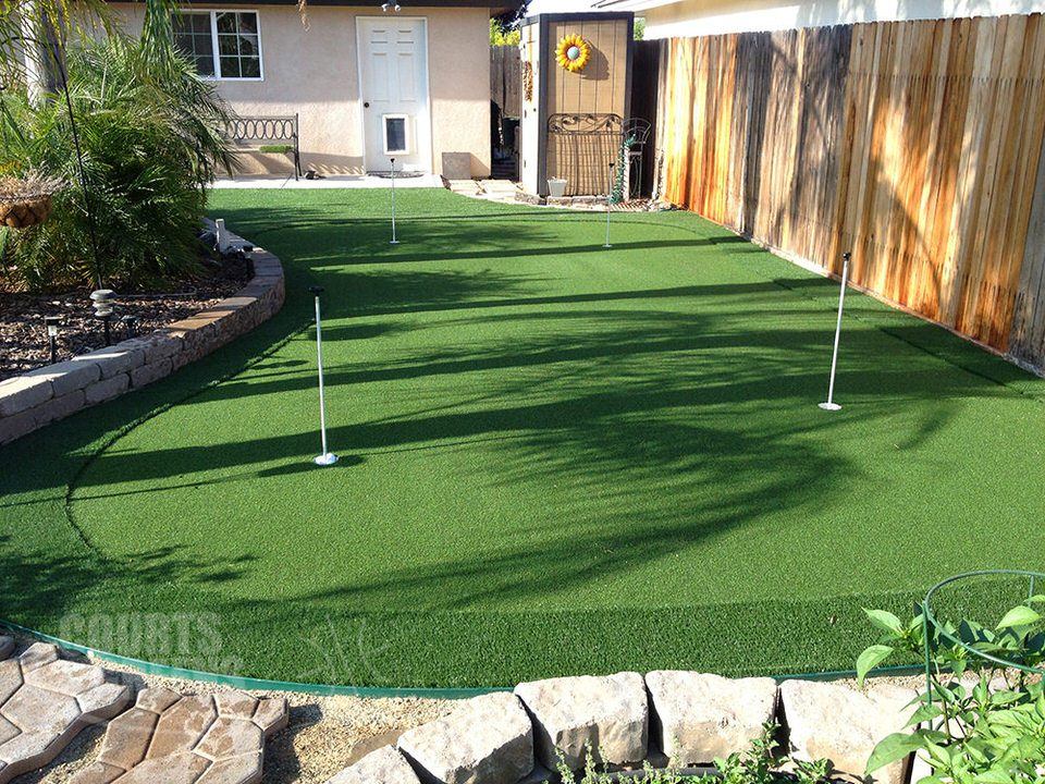 beautiful backyard putting greens by Courts and Greens in Bakersfield