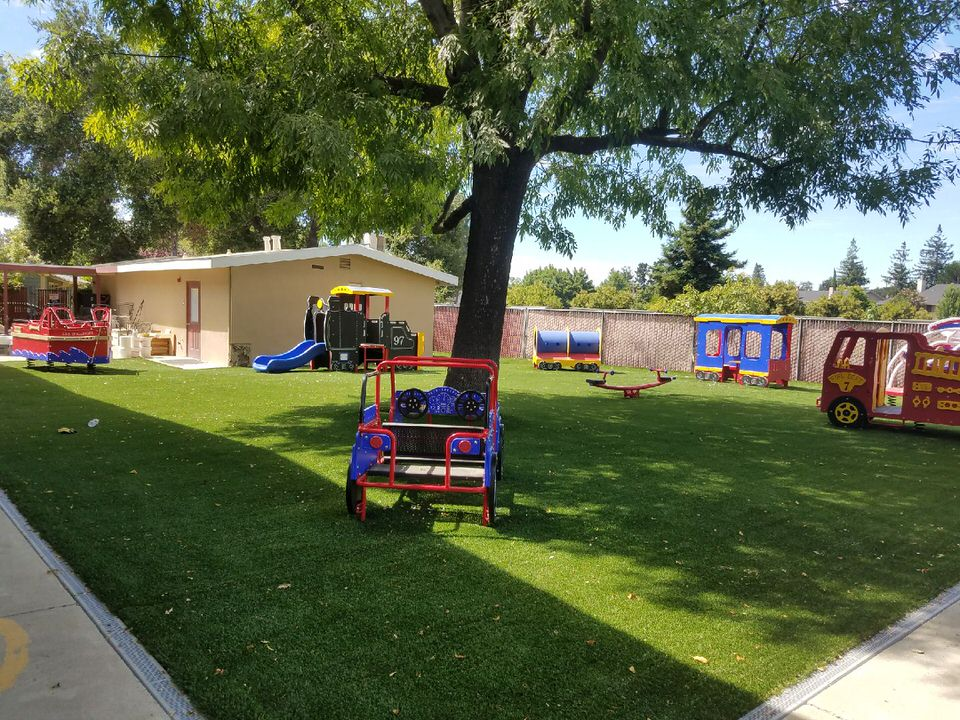 custom playground area with synthetic grass by Courts and Greens in Bakersfield