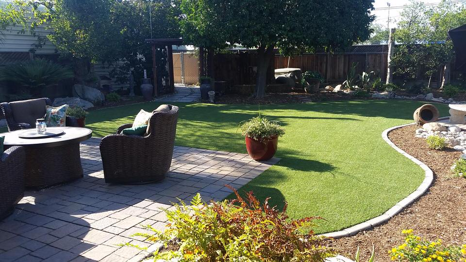 gorgeous backyard finish with syn grass install by Courts and greens in Bakersfield