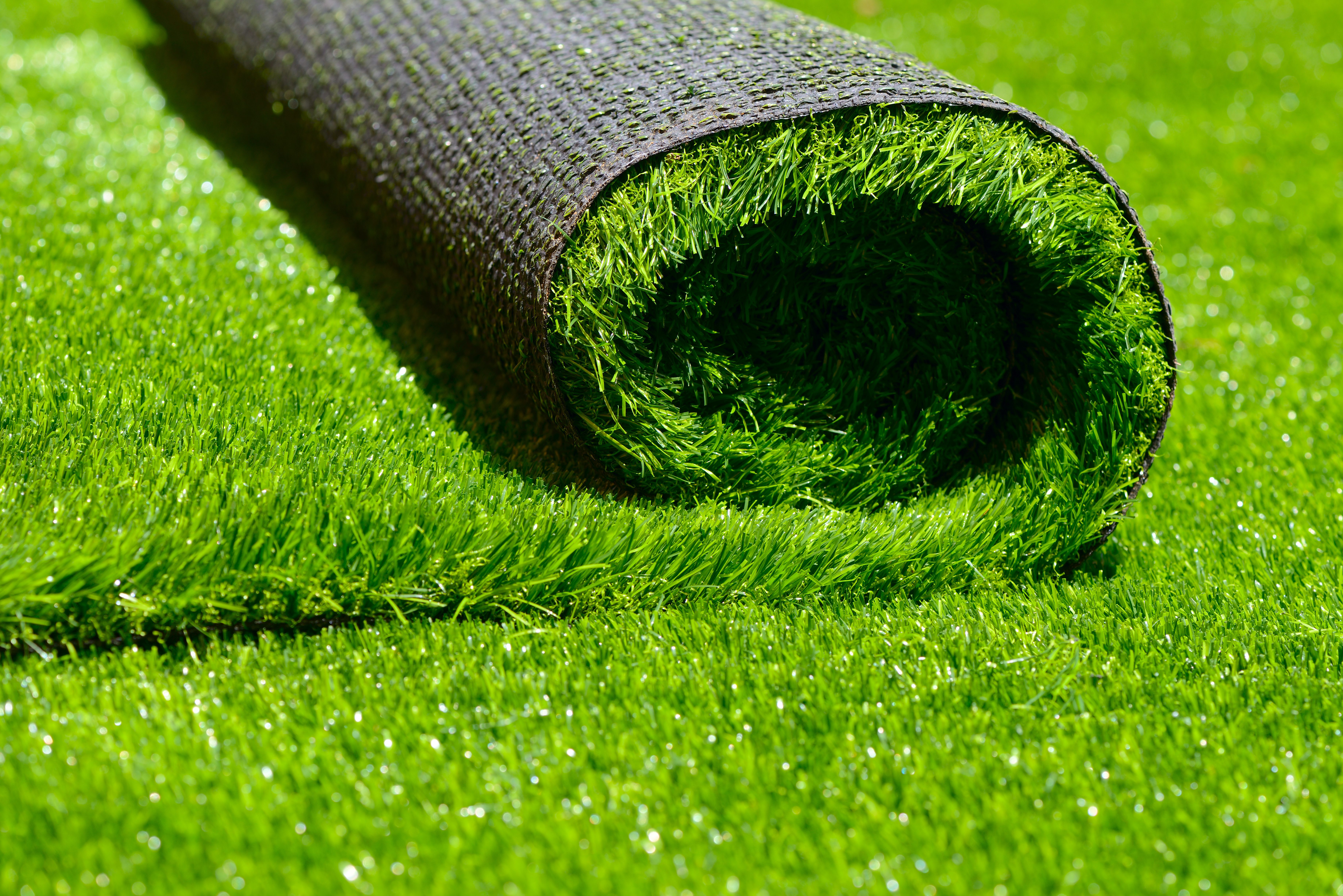 freshly cut artificial turf by Courts and greens in Bakersfield